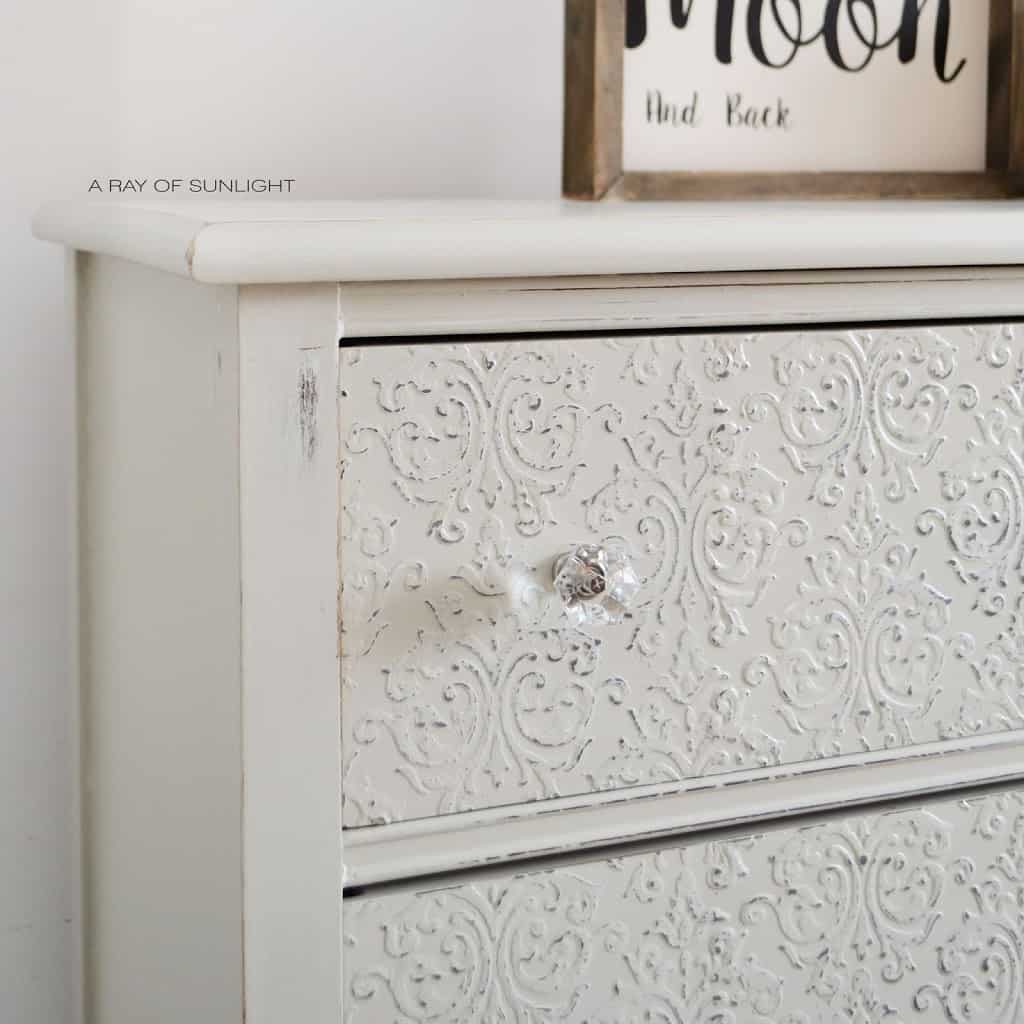 Painted Furniture Makeover : How to Add Raised Embossing to your Dresser with a Stencil and Country Chic Paint Texture Powder. Painted in a light grey Sunday Tea. Perfect for an entry way, nursery or bathroom space. #furitureakeover #paintedfurniture #vintagefurniture #upcycled #countrychicpaint
