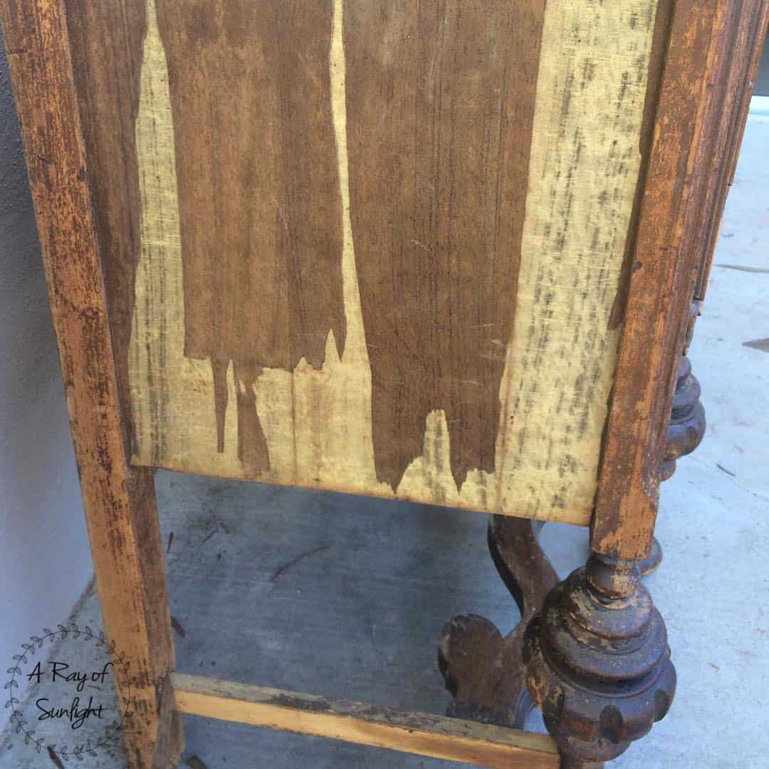 How to repair wood veneer on antique and vintage furniture. This antique buffet was ready for the trash, but we saved it by removing and repairing the wood veneer, adding some paint and stripping down the legs. By A Ray of Sunlight