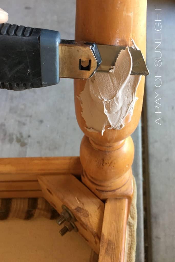 Utility knife cutting through drying bondo