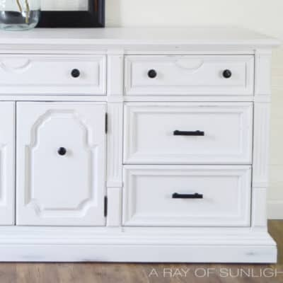 White Vintage Dresser Painted with Chalk Paint by A Ray of Sunlight