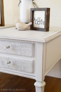 Lace Embossed Nightstands painted light grey with crystal knobs by A Ray of Sunlight
