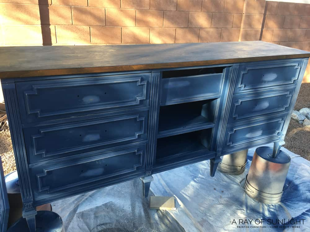 Blue Dresser turned TV Stand Being Painted