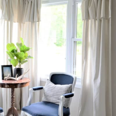 Quickly update your home on a budget with DIY modern farmhouse curtains made from Drop Cloth. The cheap, easy and no sew way to start decorating in the farmhouse style. #farmhouse #diy