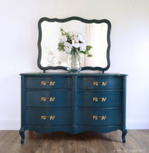 Learn how to create this navy blue finish with antique gold hardware for your own DIY furniture makeover. Painted in Country Chic Paint with the best affordable paint sprayer for refinishing furniture. By A Ray of Sunlight #paintedfurniture #navydresser #furnituremakeover #countrychicpaint #DIYfurniture