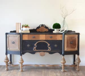 Black natural wood antique buffet by A Ray of Sunlight