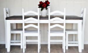 Farmhouse Rustic Dining Table Painted White with A Dark Stained Top by A Ray of Sunlight