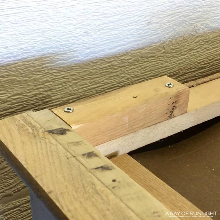 Modify the base of the dresser with a wood block