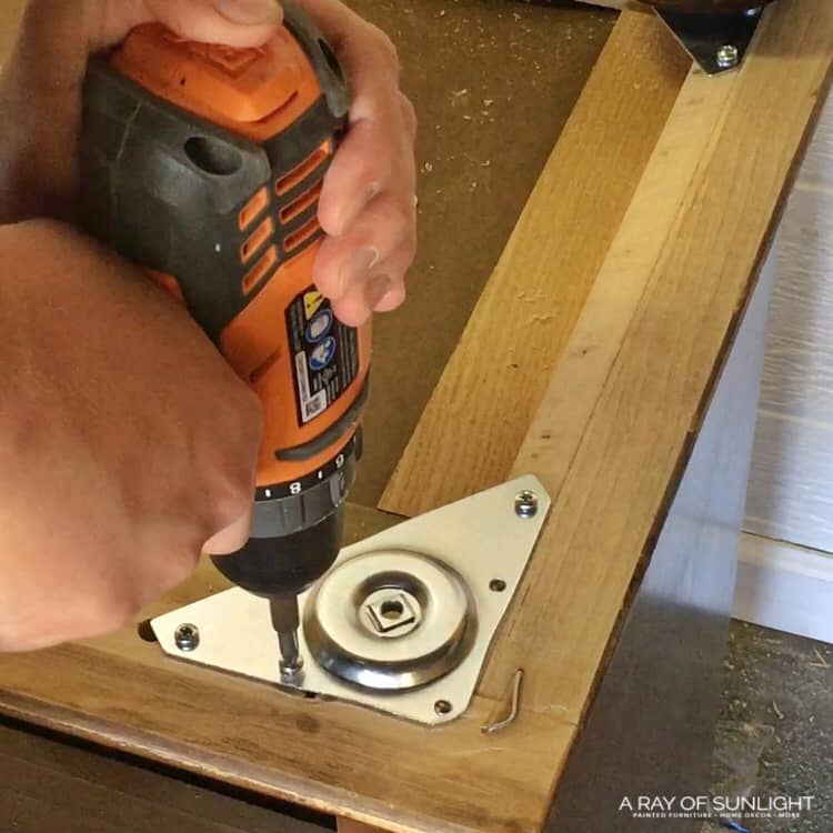 Screwing the furniture leg plate in place