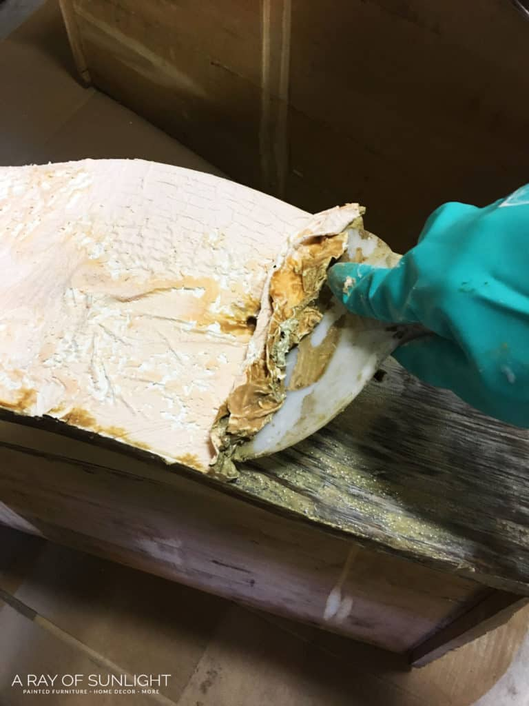 Scraping paint off of wood drawer with stripper