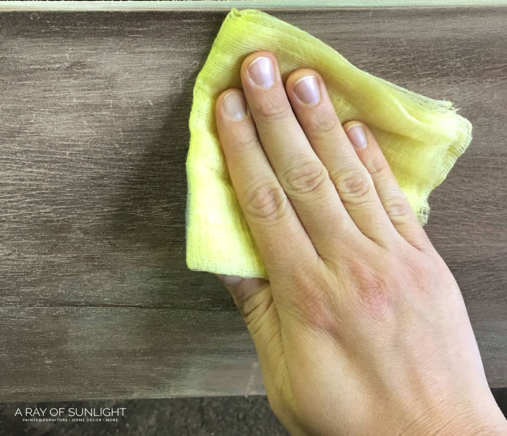 Wiping off dust with a tack cloth