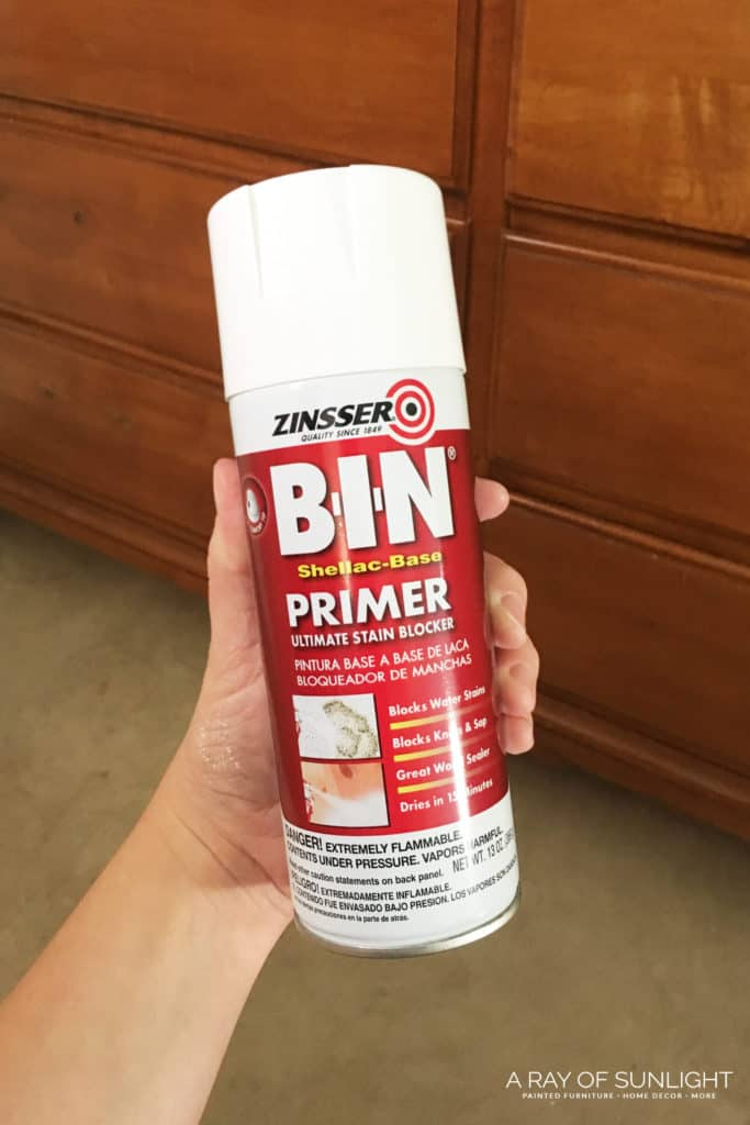 How to paint laminate or slick furniture and make the paint stick. This is the best primer that will prevent bleedthrough (you know those red, pink, orange or yellow spots that show up and won't go away after you paint).