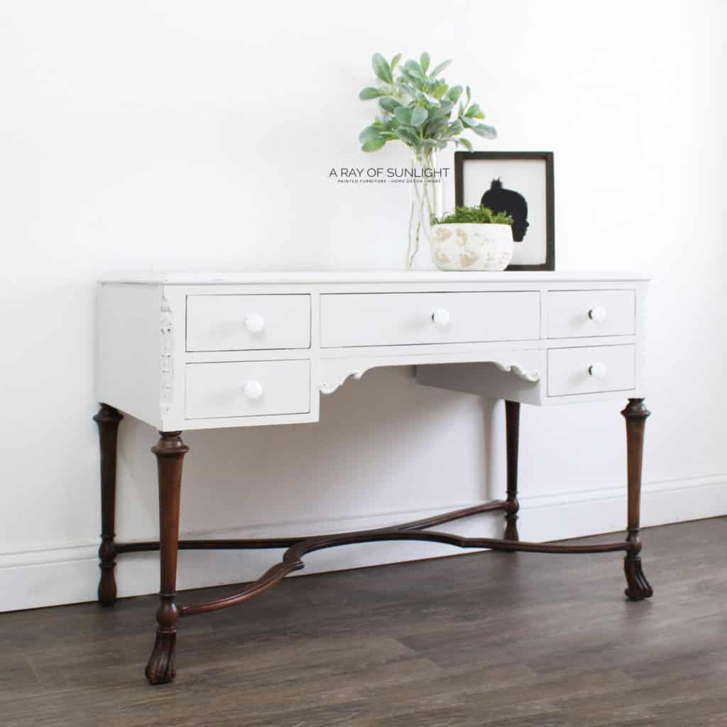 Angled view of light gray desk with wood legs