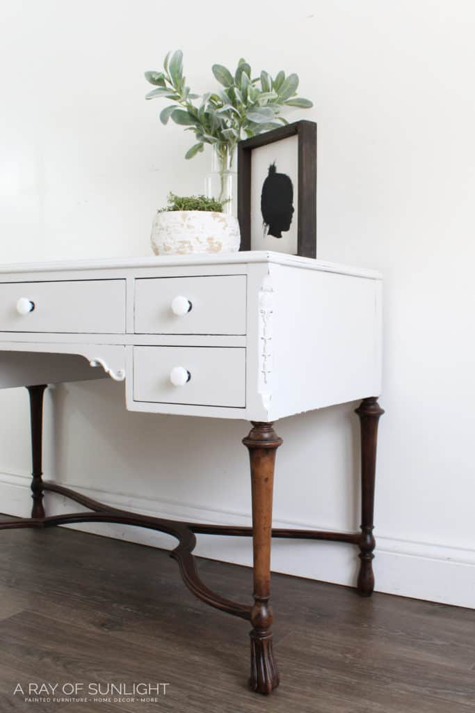 light gray desk with wood legs sideview