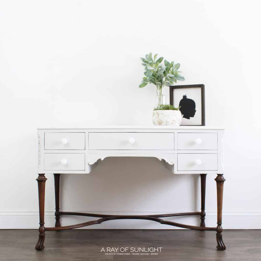 Gray desk with weathered wood legs and white knobs