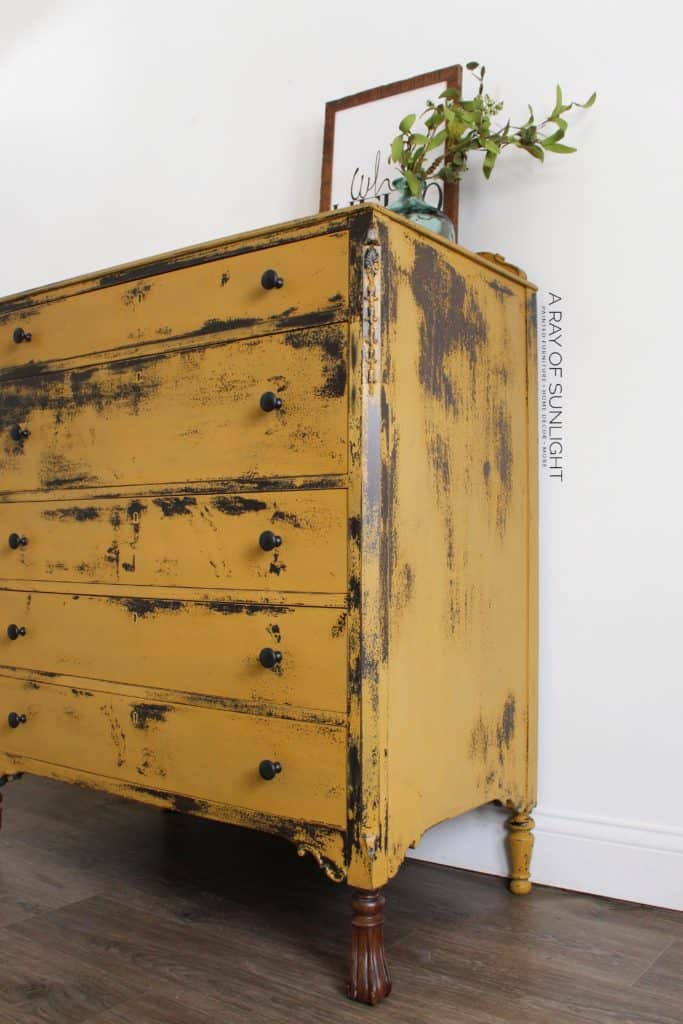 Side view of chippy mustard yellow dresser