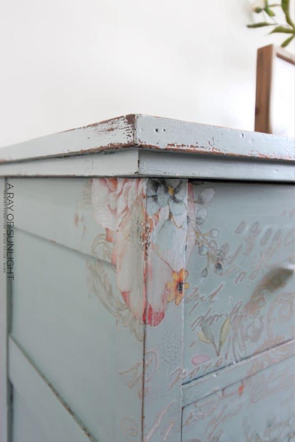 Top left corner of teal dresser
