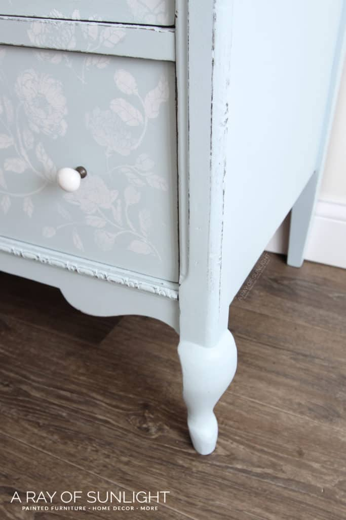Closeup of side and leg of dresser