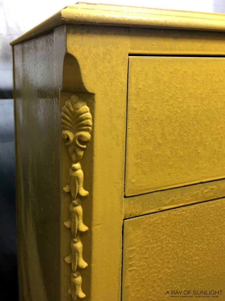 yellow painted dresser with drips