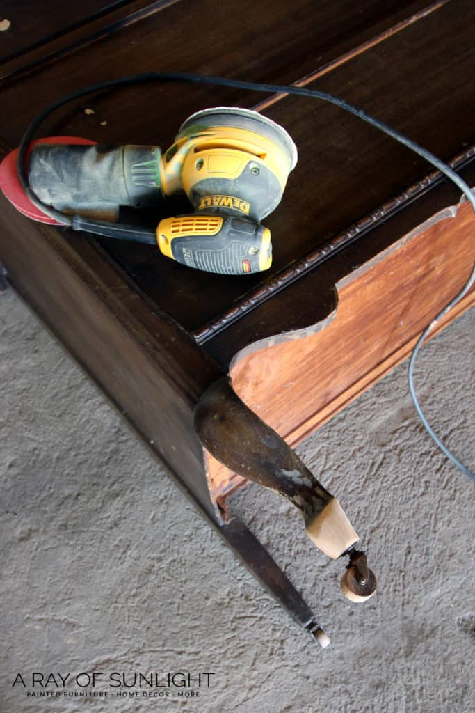 repairing feet by sanding them round with power sander
