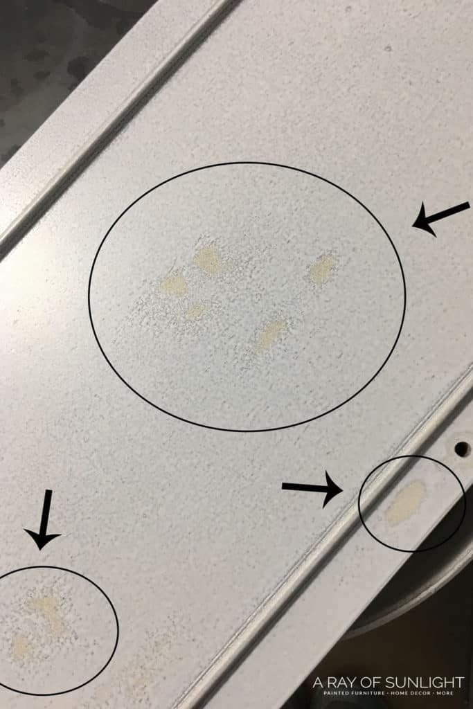 Bleedthrough staining through white paint on furniture