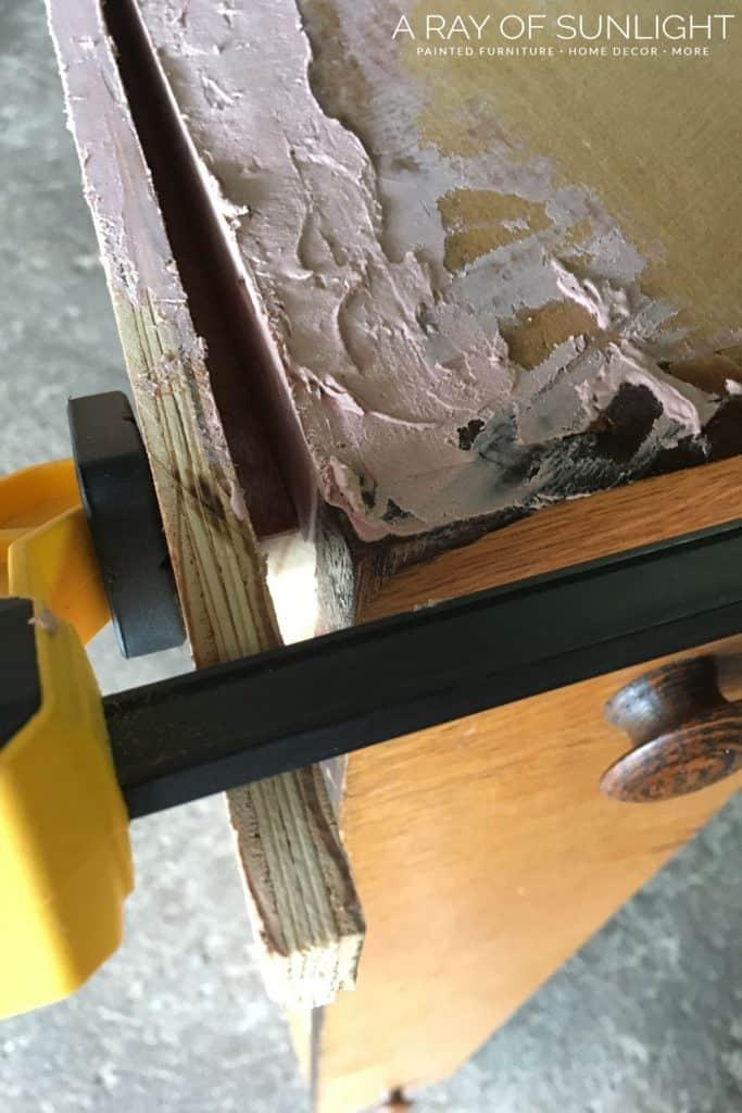Remove wood box around broken drawer and bondo