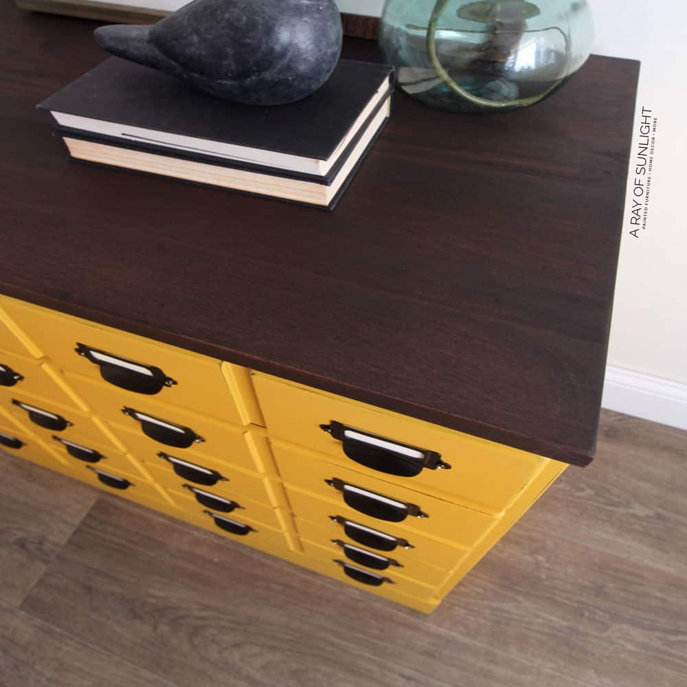 mustard yellow dresser with stained top