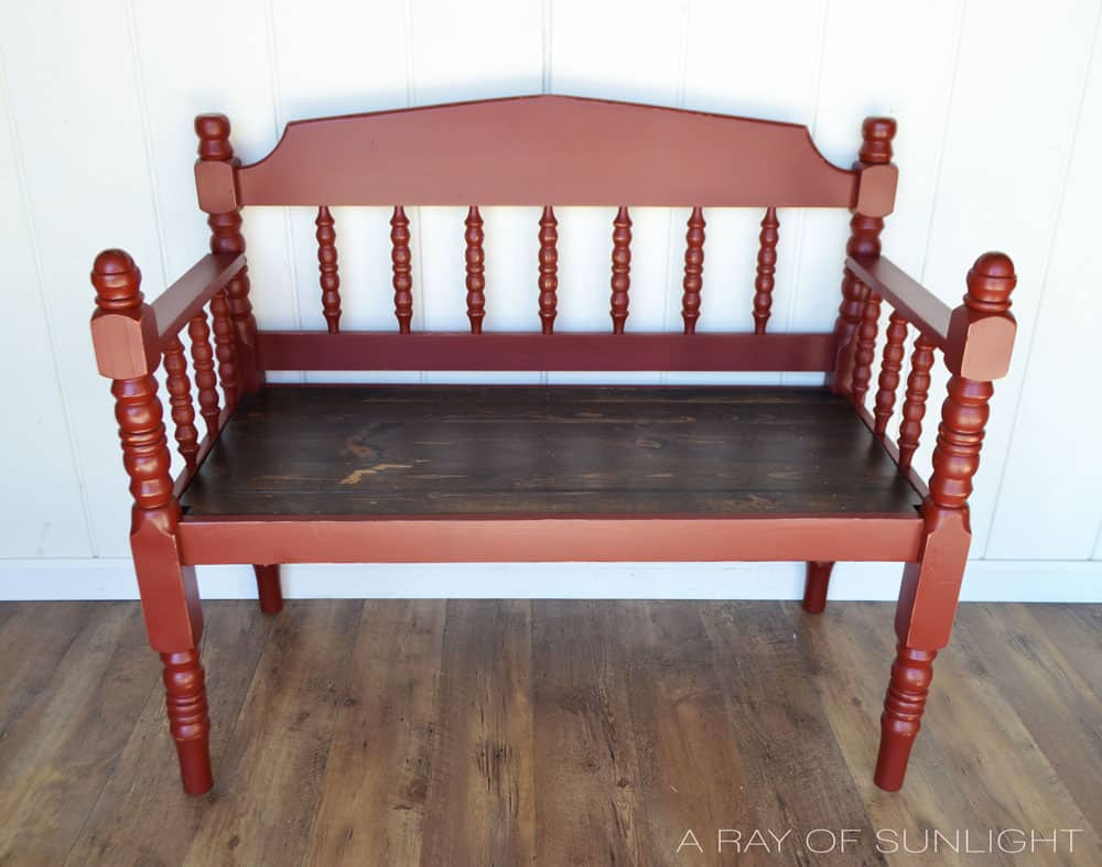 rustic red bench made from headboard and footboard