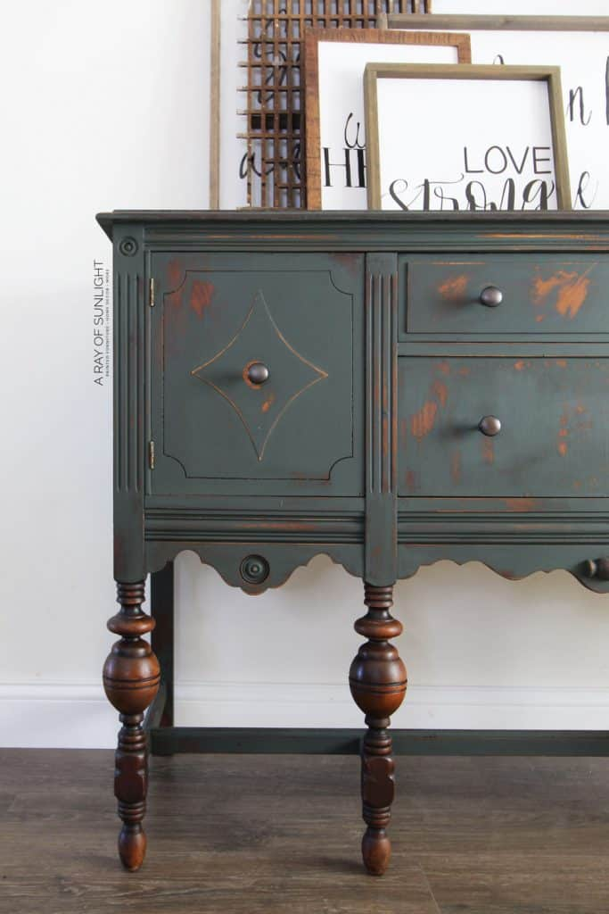 dark green buffet with stained wood legs