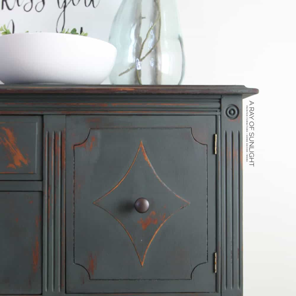 closeup of dark green painted buffet
