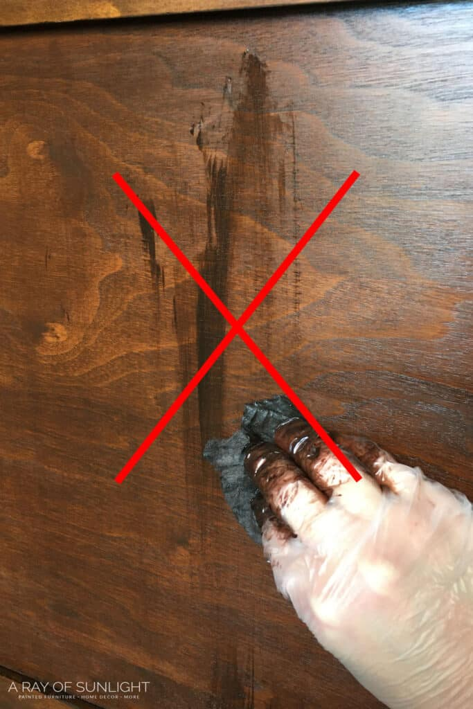 Don't wipe the stain in a different direction from the wood grain