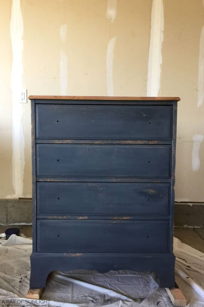 navy blue painted dresser during makeover