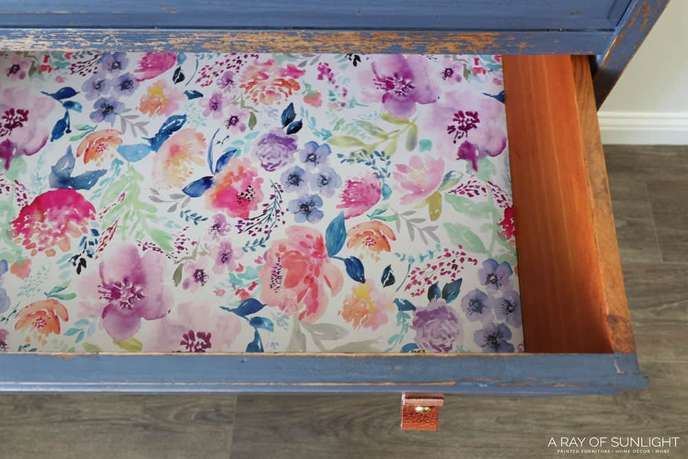 Drawers lined with floral wrapping paper