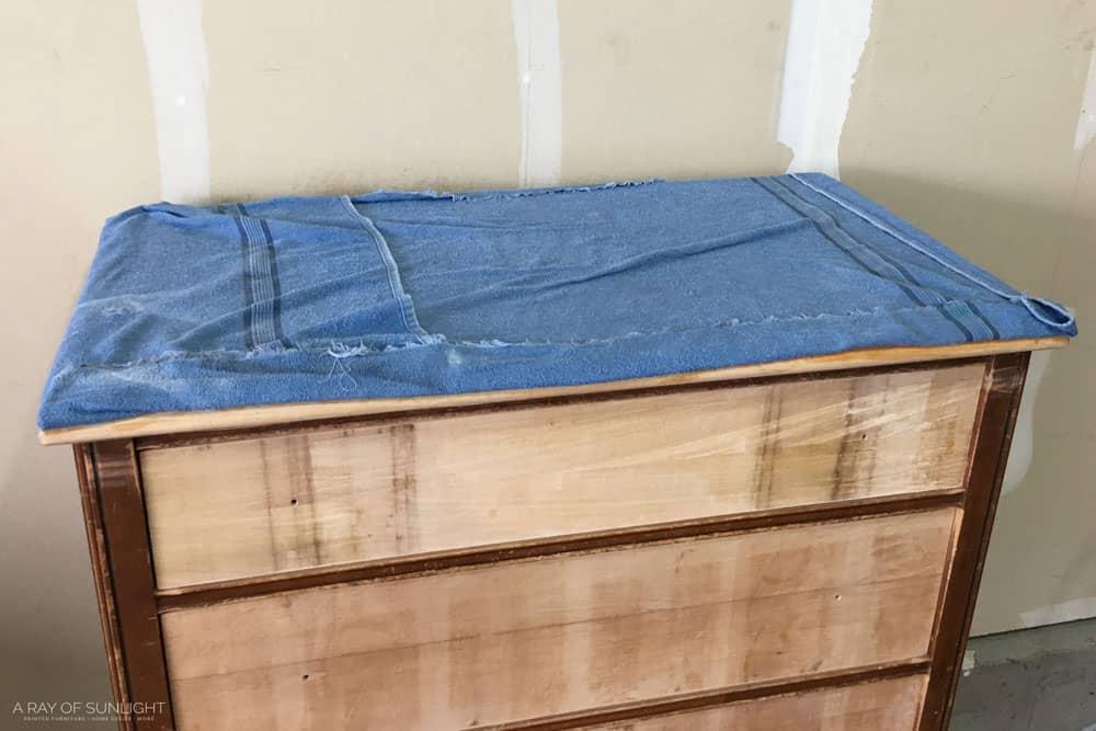 wet towel on damaged veneer