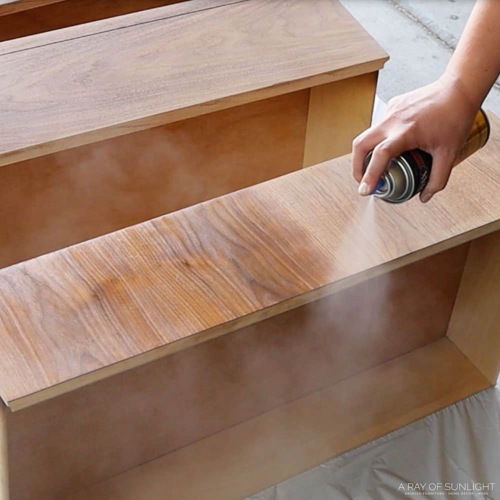 spraying minwax fast drying polyurethane on dresser drawers