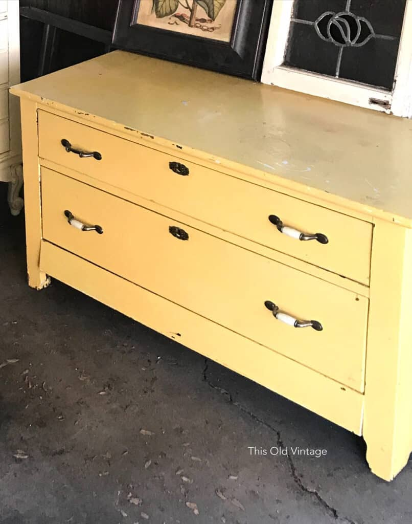 Before - yellow painted dresser