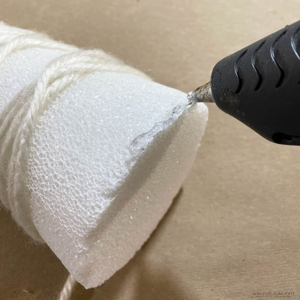 hot glue to hold on the yarn