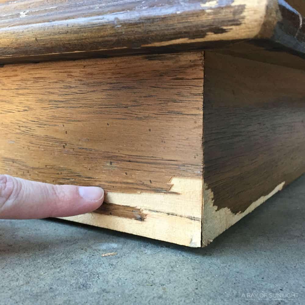 chipped veneer on corner of furniture