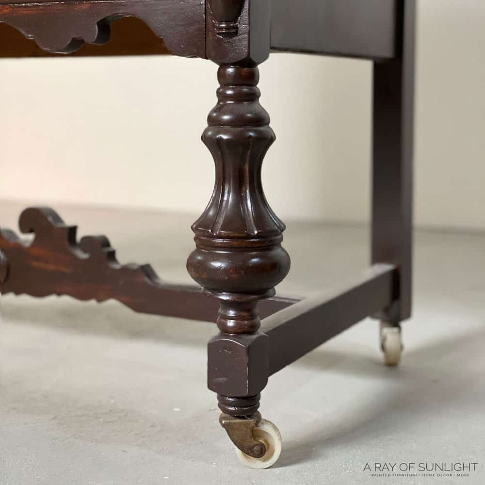 antique buffet wood leg, before removing wood stain