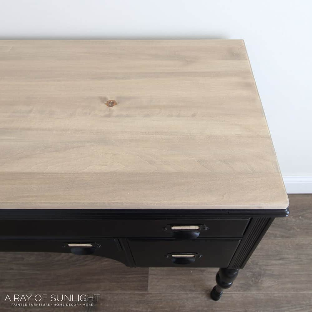 stained wood top on black painted desk