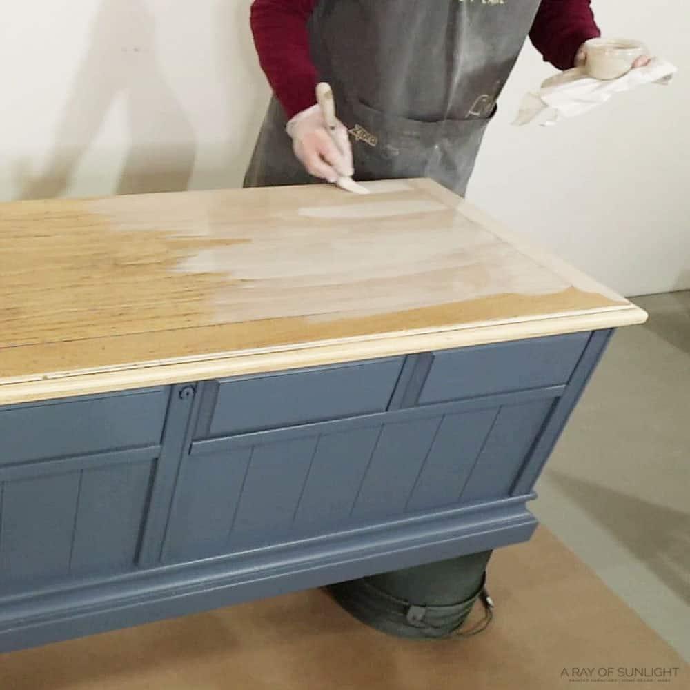 brushing whitewash onto cedar chest top