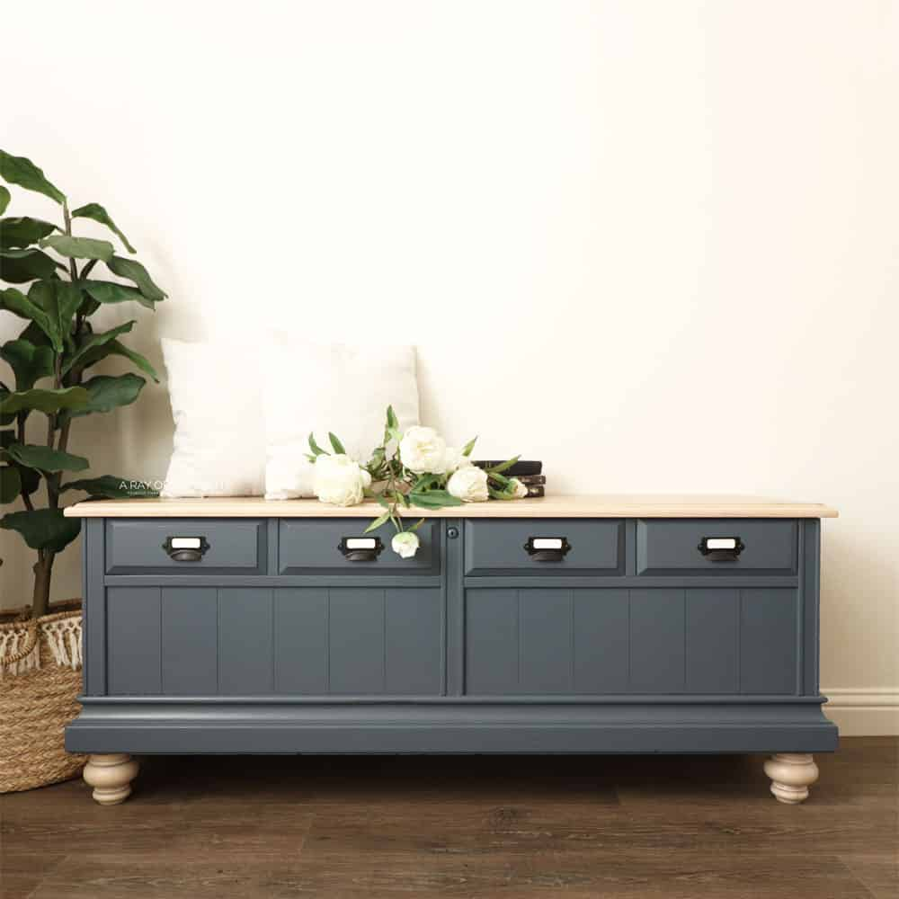cedar chest makeover after painted blue with whitewashed legs and top. Topped with farmhouse decor
