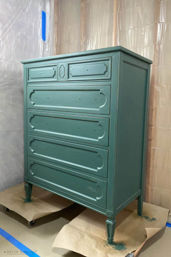 green dresser with clear topcoat on it