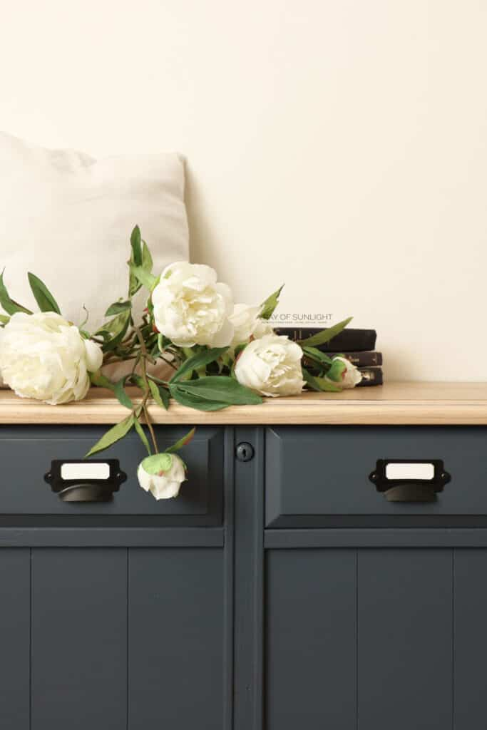 closeup of blue painted cedar chest with whitewashed top and card catalog pulls