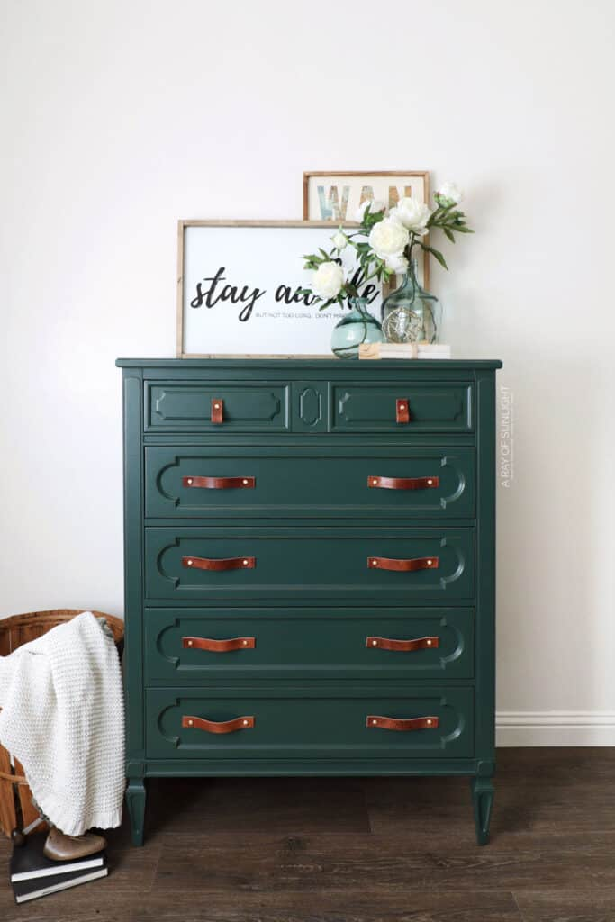 full shot of green painted dresser with farmhouse decor.