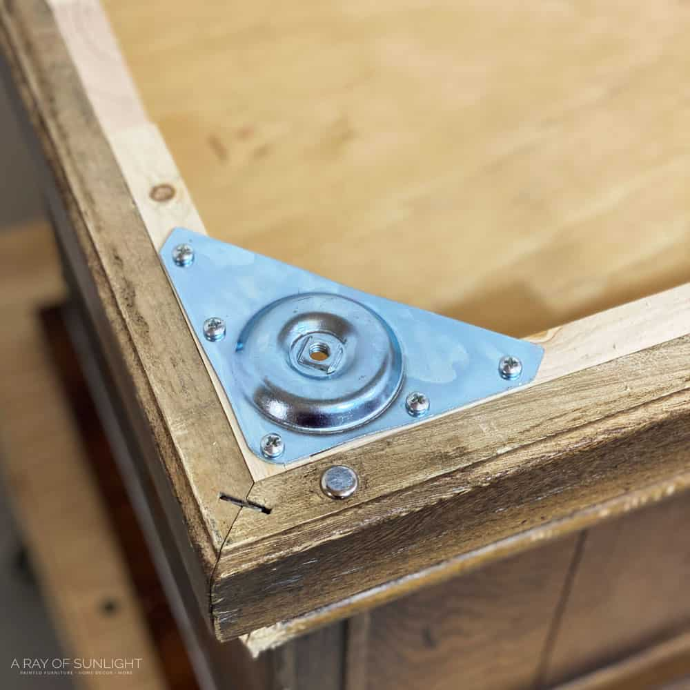 heavy duty leg hardware plate attached to the cedar chest