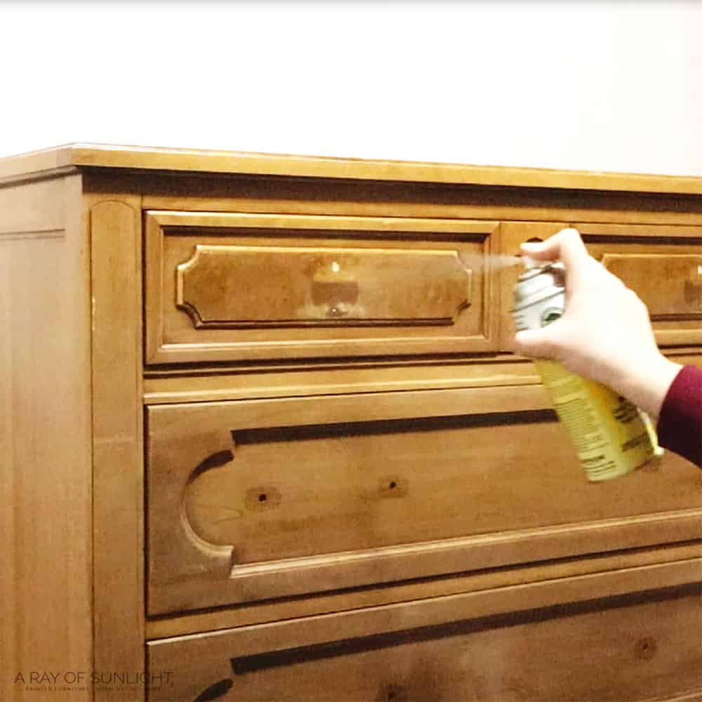 spraying clear shellac to prevent bleed through before painting.