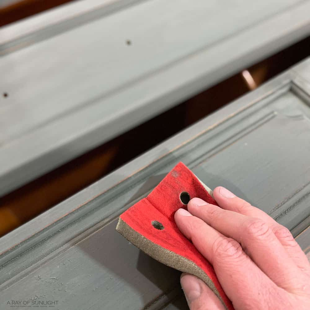 sanding with foam sanding pad to remove brush marks in chalk paint