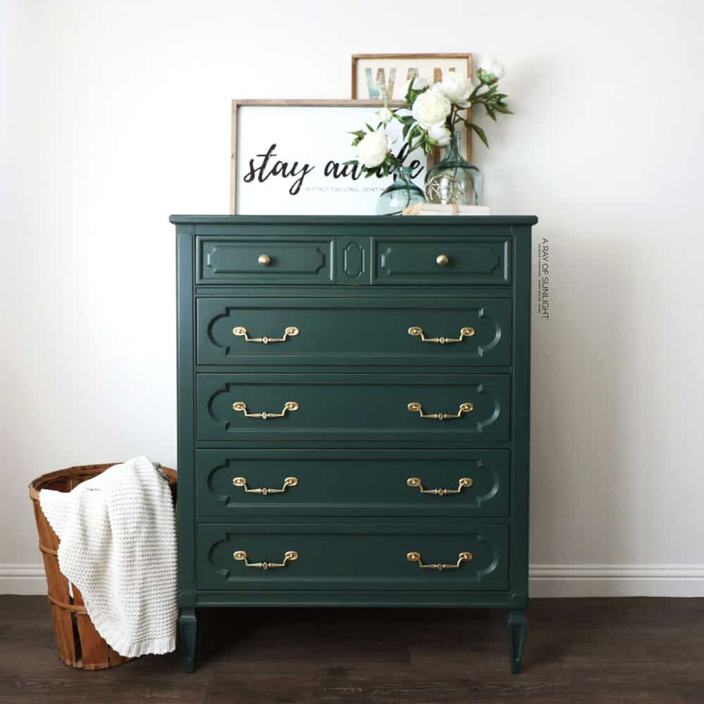 cleaned brass hardware on dark green painted dresser
