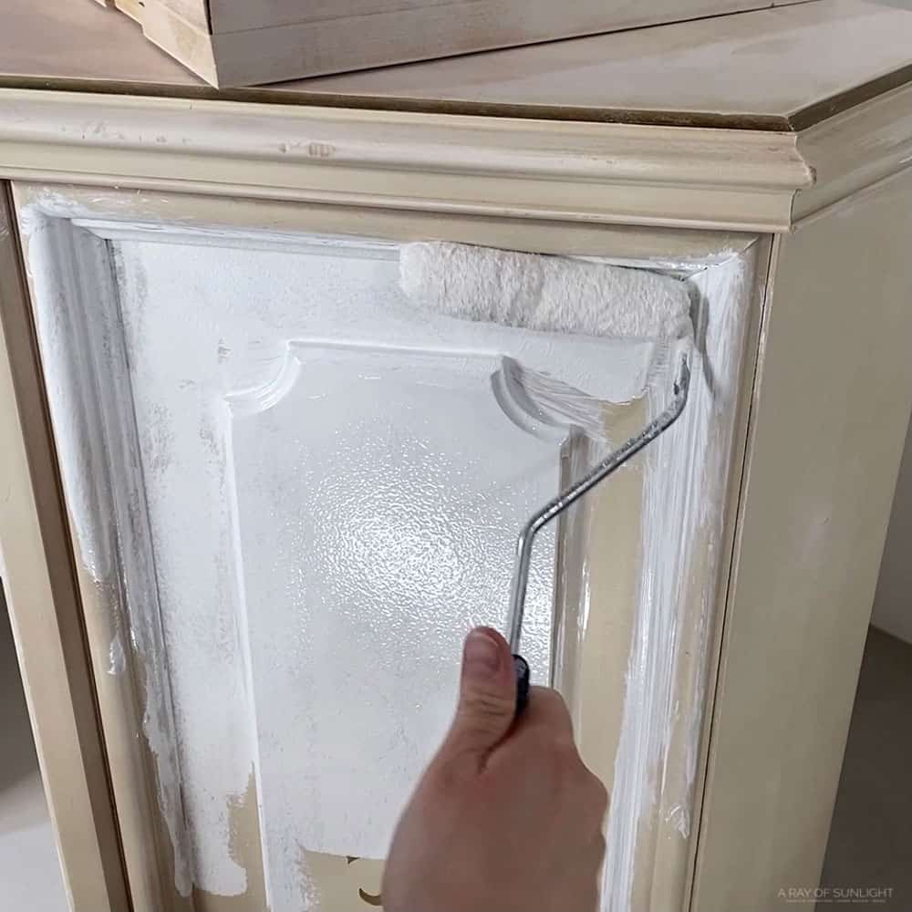 rolling BIN shellac based primer on the cabinet