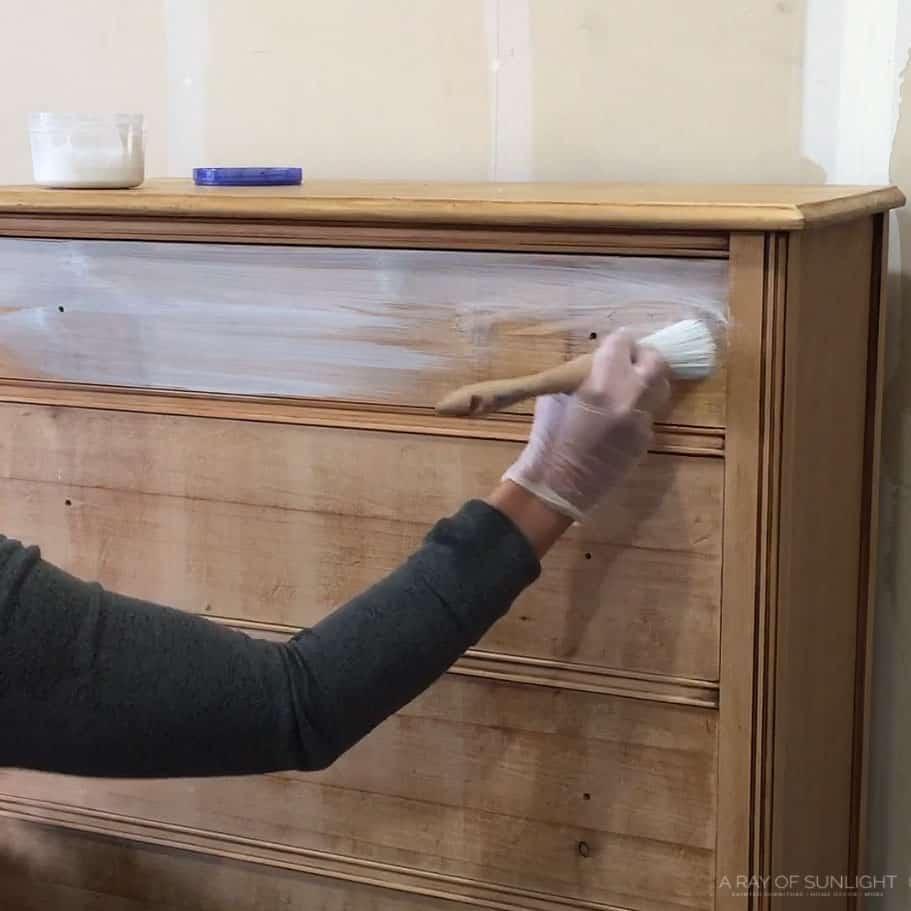 brushing the whitewash onto a drawer